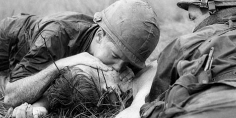 Medic James Callahan trying to resuscitate a comrade